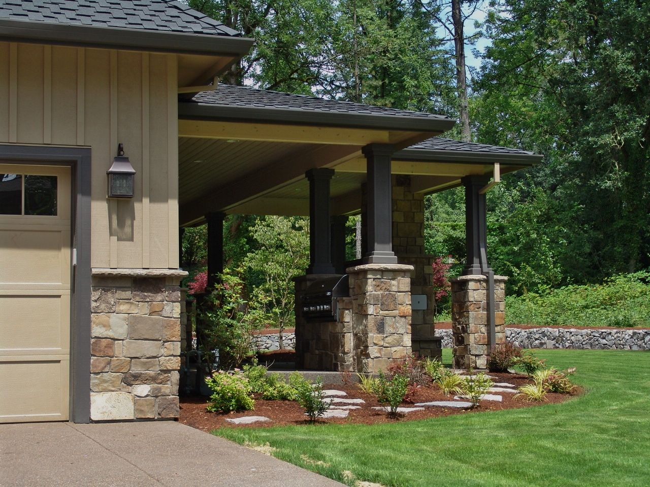 natural stone veneer  stone around garage  wainscot  outdoor living  outdoor fireplace  stone