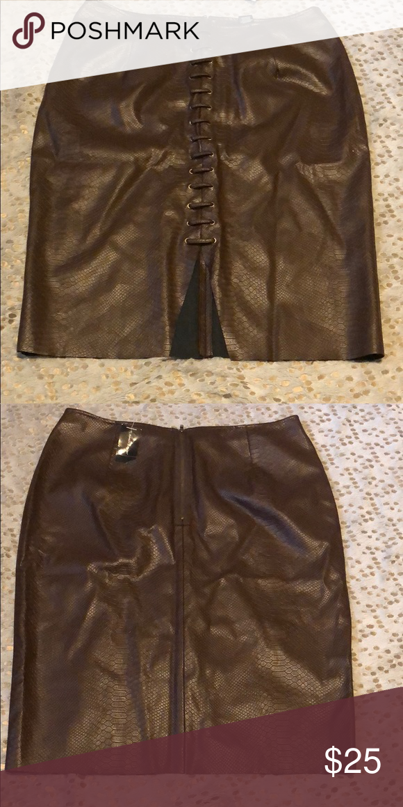 b79646d2e1c0b Plus size faux leather skirt Brown plus size faux leather skirt. Front slit  and lace up design. Back zipper! Ashley Stewart Skirts Mini
