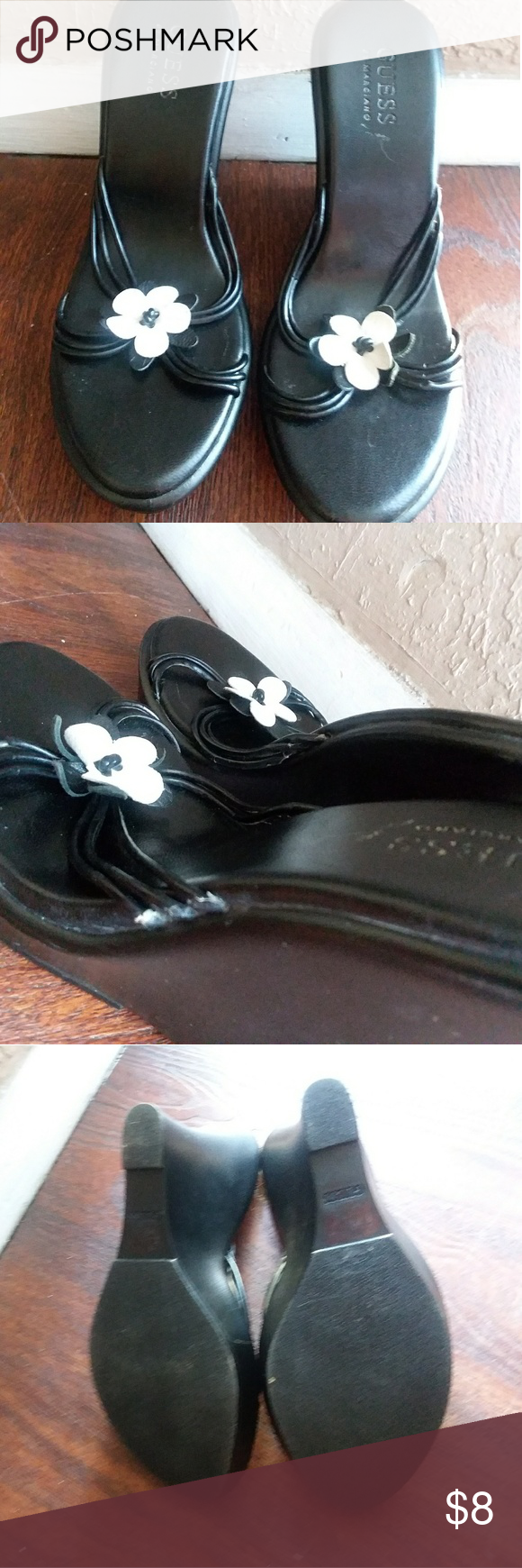 Guess wedge sandals Black guess wedge sandals has thin straps with white flower on top 4 inch wedge does show signs of wear on the sides of straps but not to noticeable and doesn't affect wear other than that good used condition size 5. Please refer to all pictures. Guess by Marciano Shoes Sandals