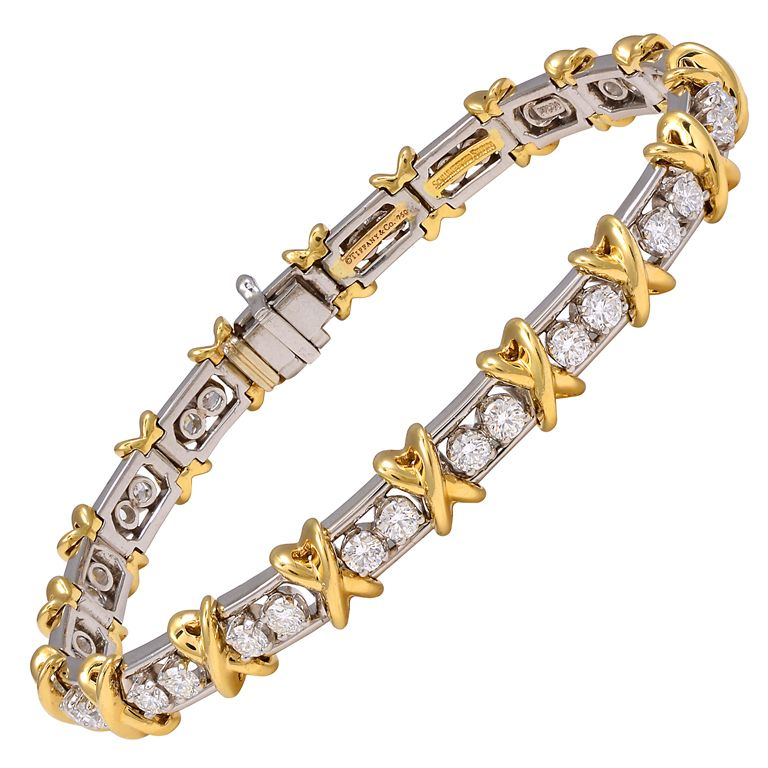 TIFFANY & CO SCHLUMBERGER 36 Stone Bracelet Brillant cut round diamonds 2.95cts set in platinum and 18k gold, interspersed with gold x's. 2000s