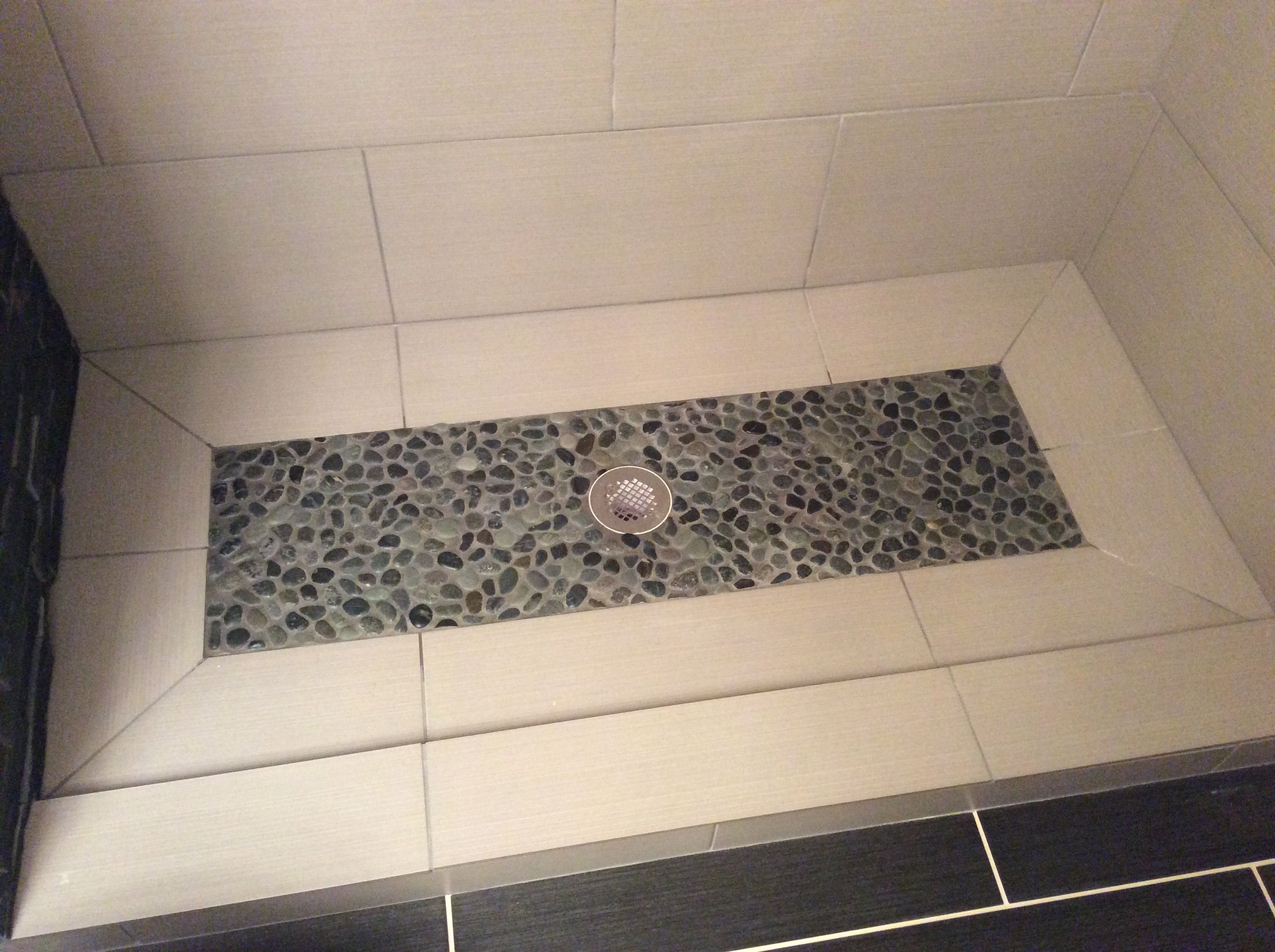 We Used Black Stone Effect Tile And Large White Tile For Shower