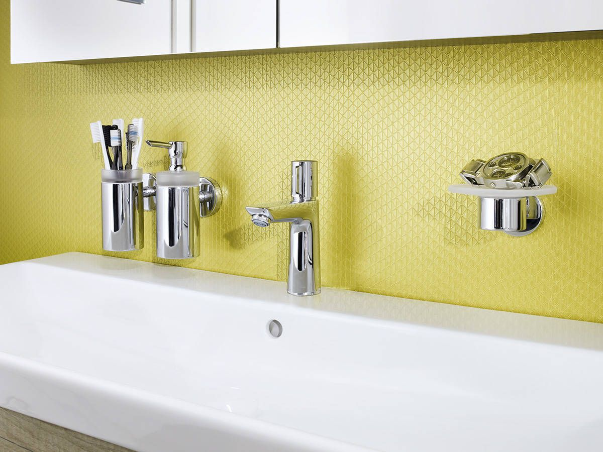 Bathroom with a pop of color, yellow, showing off the hansgrohe ...