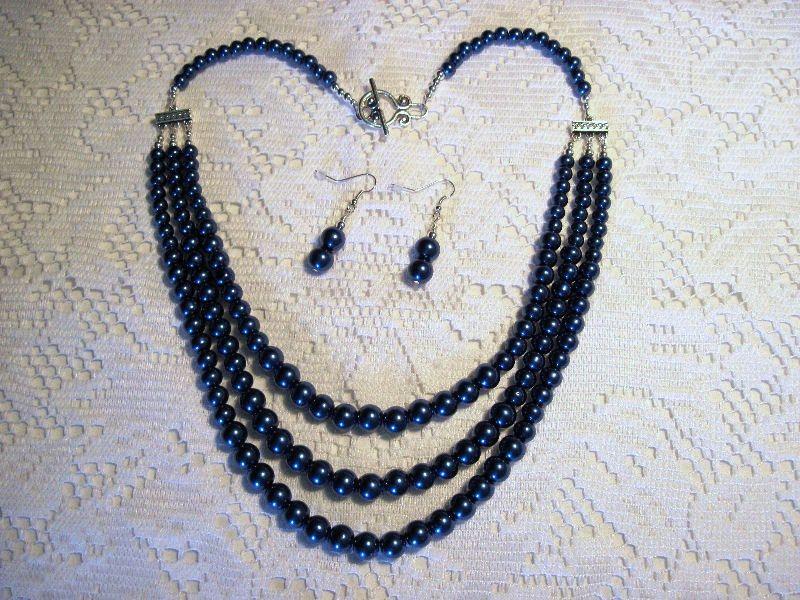 3-Strand Navy Blue Shiney Glass Pearls and Dangle Earrings. $24.00, via Etsy.