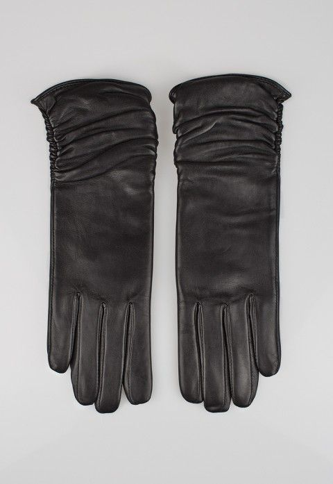 Long leather gloves | £45 | Fine leather gloves with a soft knit lining and a long ruched cuff to keep the wrists warm.