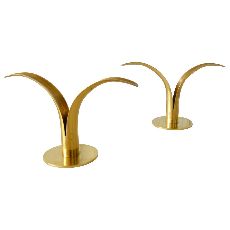 Pair of polished brass candlesticks by ivar aleniusbjork for ystad