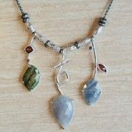 One of a kind sapphire necklace with handmade and hand textured beads in white rhodium plated sterling silver on adjustable oxidized sterling silver chain by Q Evon.