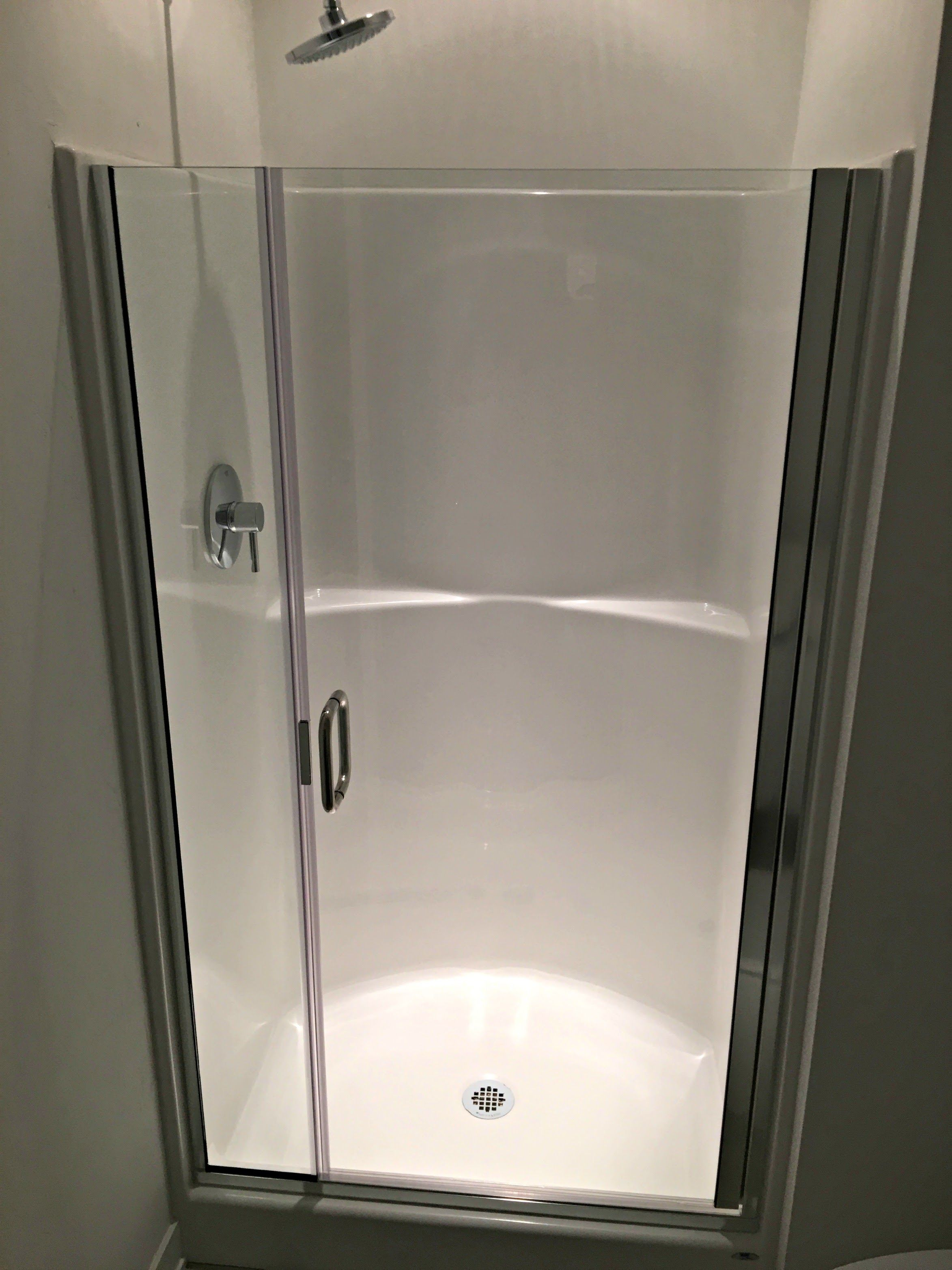 Hybrid Shower Door And Panel On An Acrylic Unit With No Header