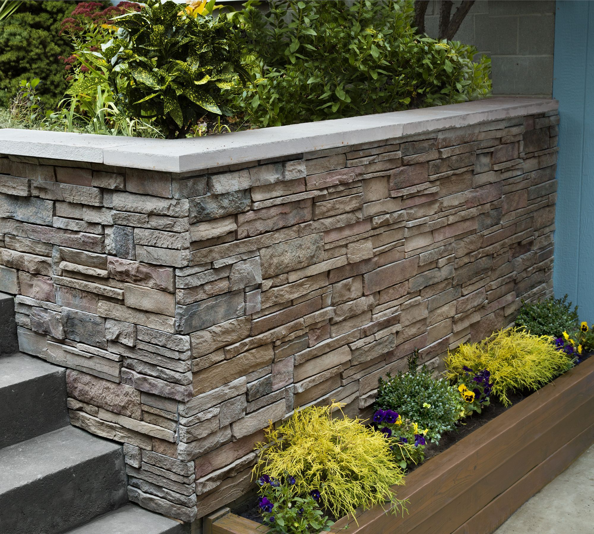 Dressing Up A Block Wall With Stone Veneer Panels With This Old House Landscape Contractor Roger Cook Exterior Stone Stone Facade Exterior Wall Panels