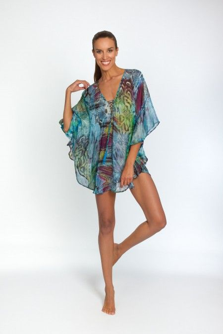 49b3f941fc96 This Eliptica kaftan comes in a gorgeous eyecatching peacock print in  vibrant blues with flashes of violet and green throughout. Its circular  shape makes it ...