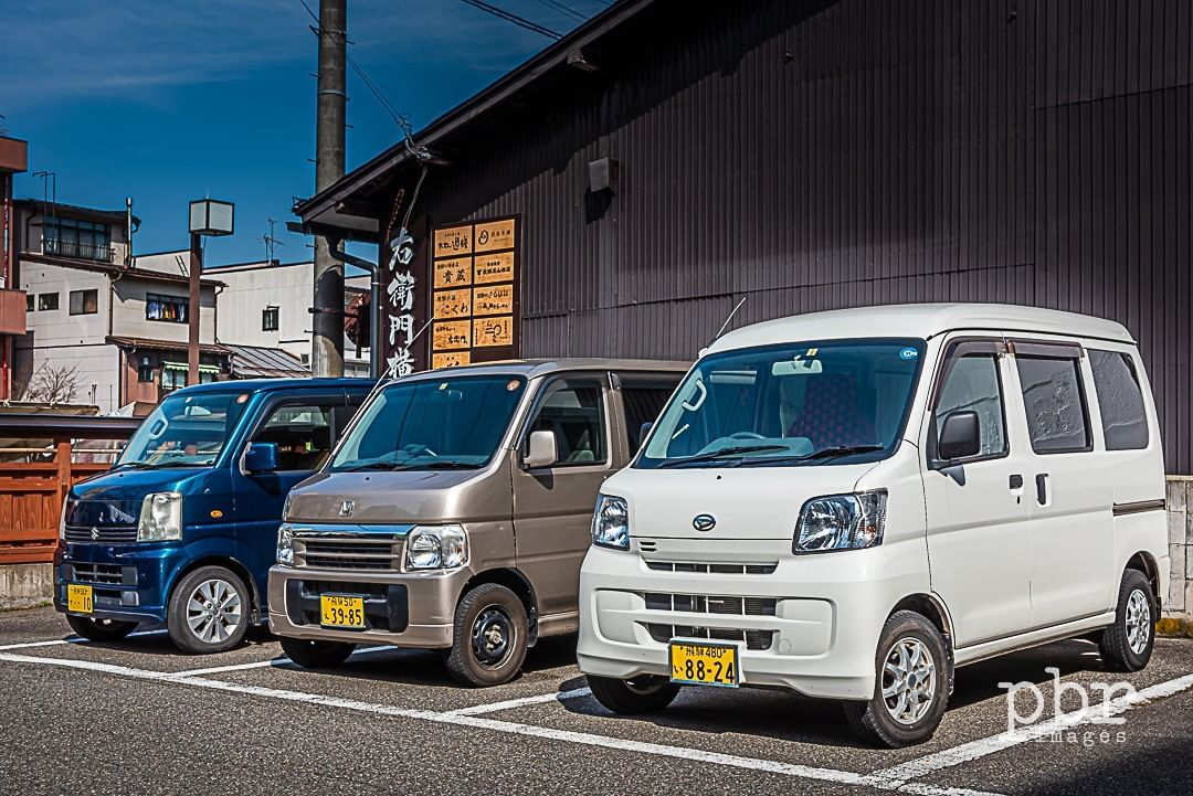 A Selection Of Japanese Kei Car Microvans In Takayama Every
