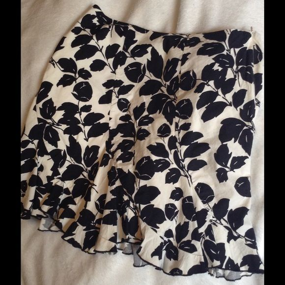 White House black market skirt Knee length floral with a ruffle at the bottom White House Black Market Skirts