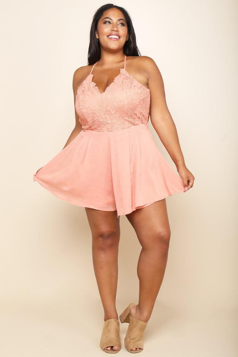 721bec170f A plus size mini sleeveless skater dress with a scalloped V-neckline and an  open back. Features a lace overlay above the cinched waist.