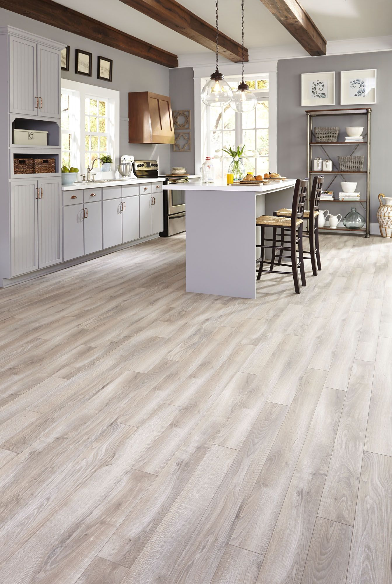 Gray tones mixed with light creams and tans suggest a floor worn