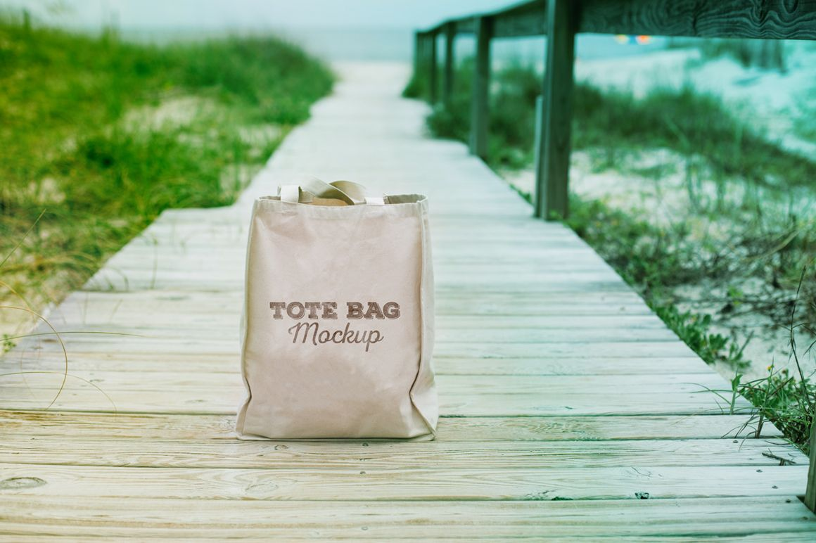 Download Tote Bag On A Beach Realistic Psd Mockup Pixelify Best Free Fonts Mockups Templates And Vectors Tote Bag Bag Mockup Tote