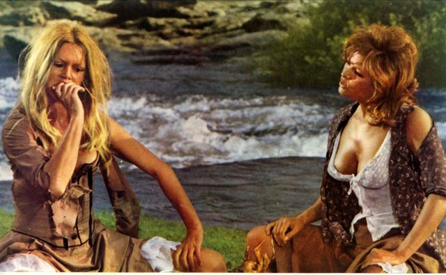 Brigitte Bardot and Claudia Cardinale in Les Pétroleuses (The Legend of Frenchie King) in 1971.