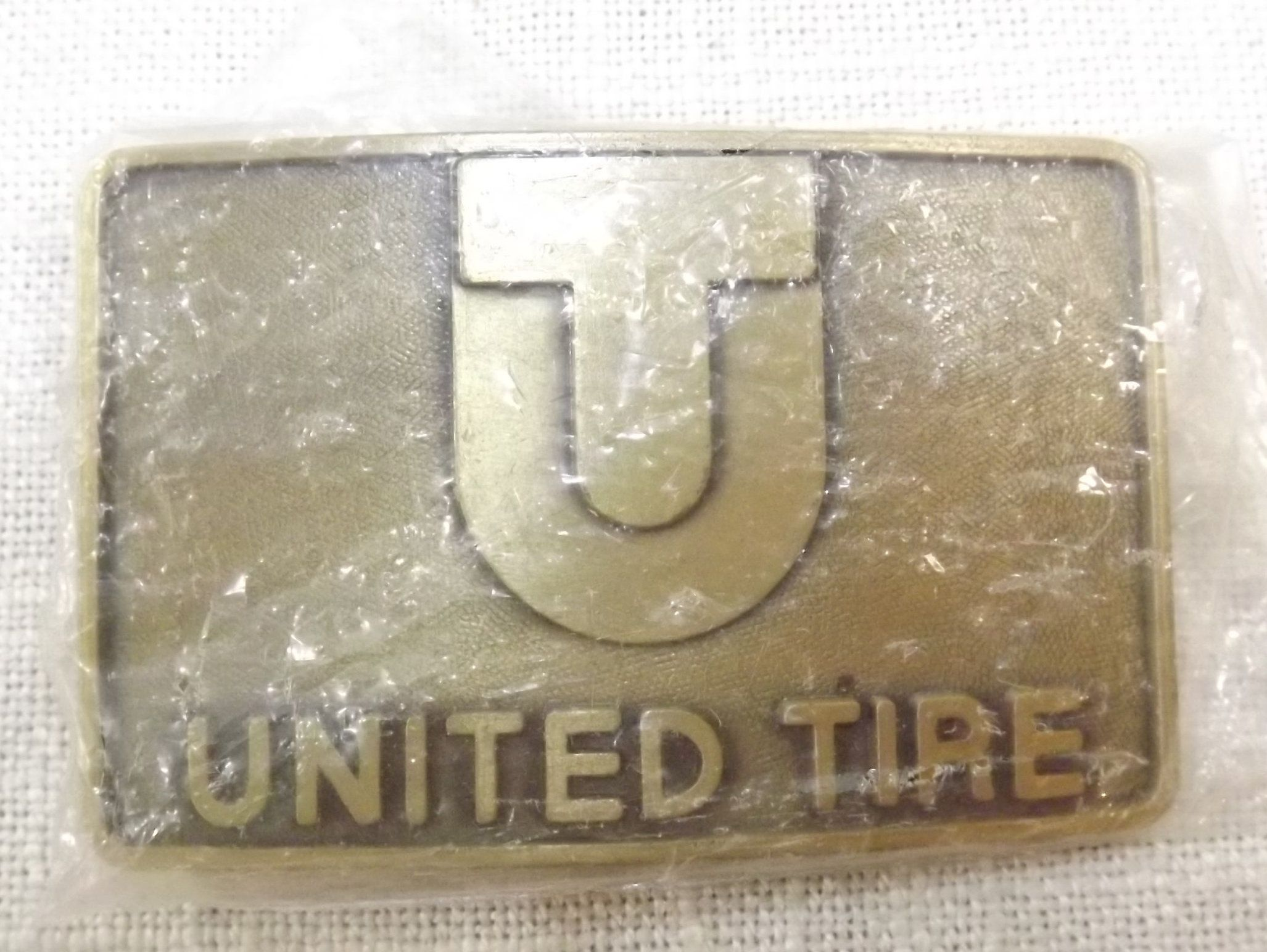United Tire Belt Buckle, Vintage Heavy Equipment
