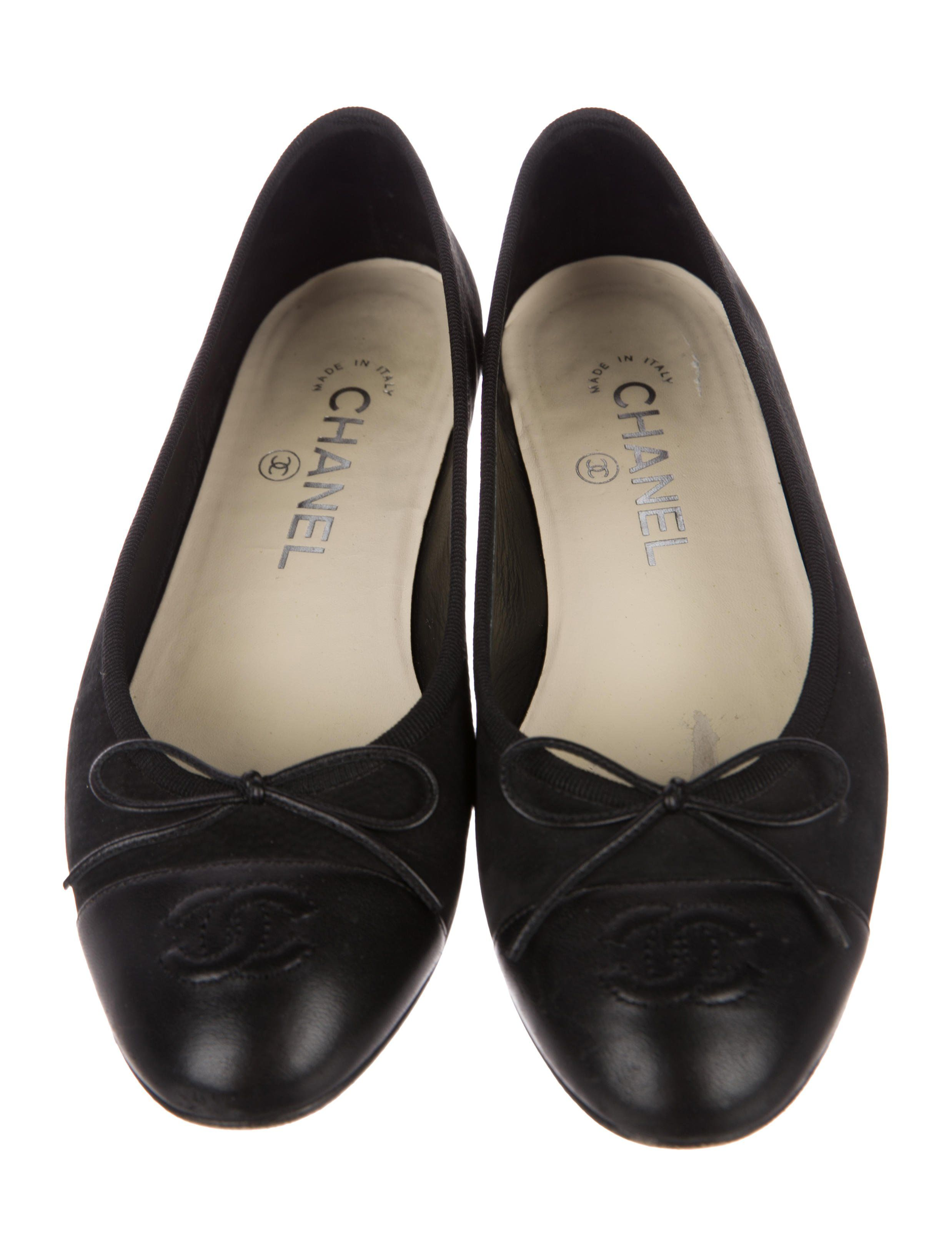 7c8acd20dd10 Black suede Chanel ballet flats with leather cap toes featuring CC accents