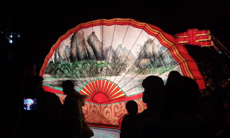 Yangshuo, China--a lantern fan depicting the Lime Mountains in the Old Park the night of Lantern Festival.