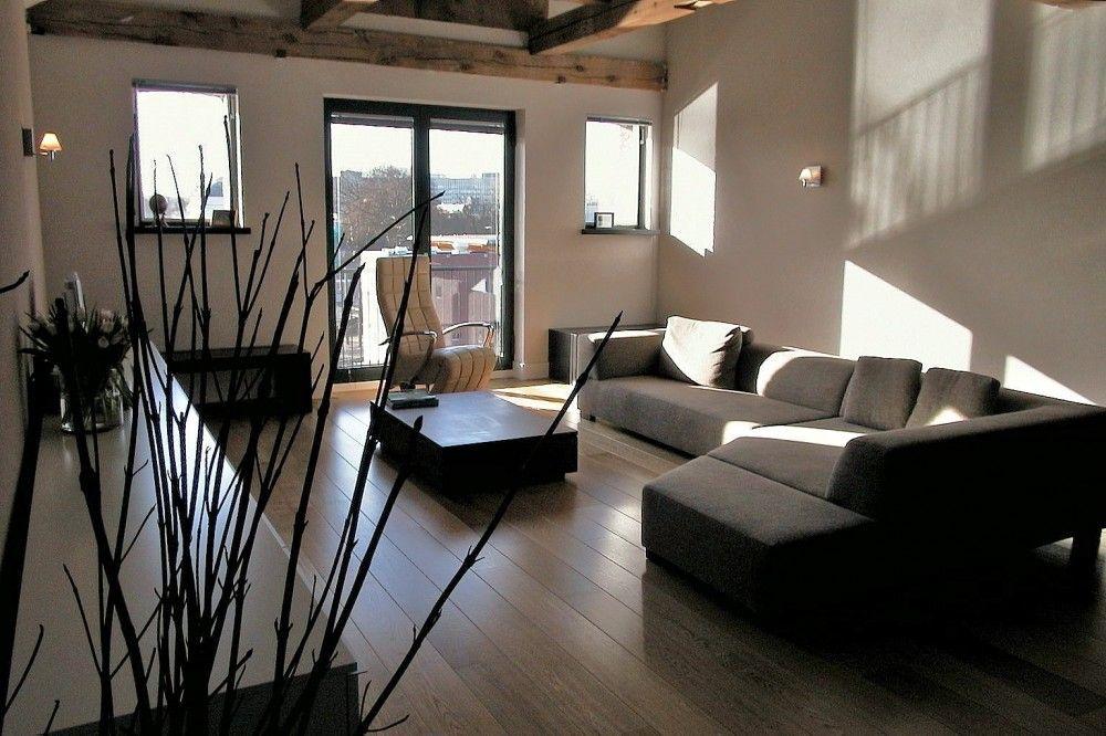 woonkamer inrichten in een loft strak en modern huiskamer