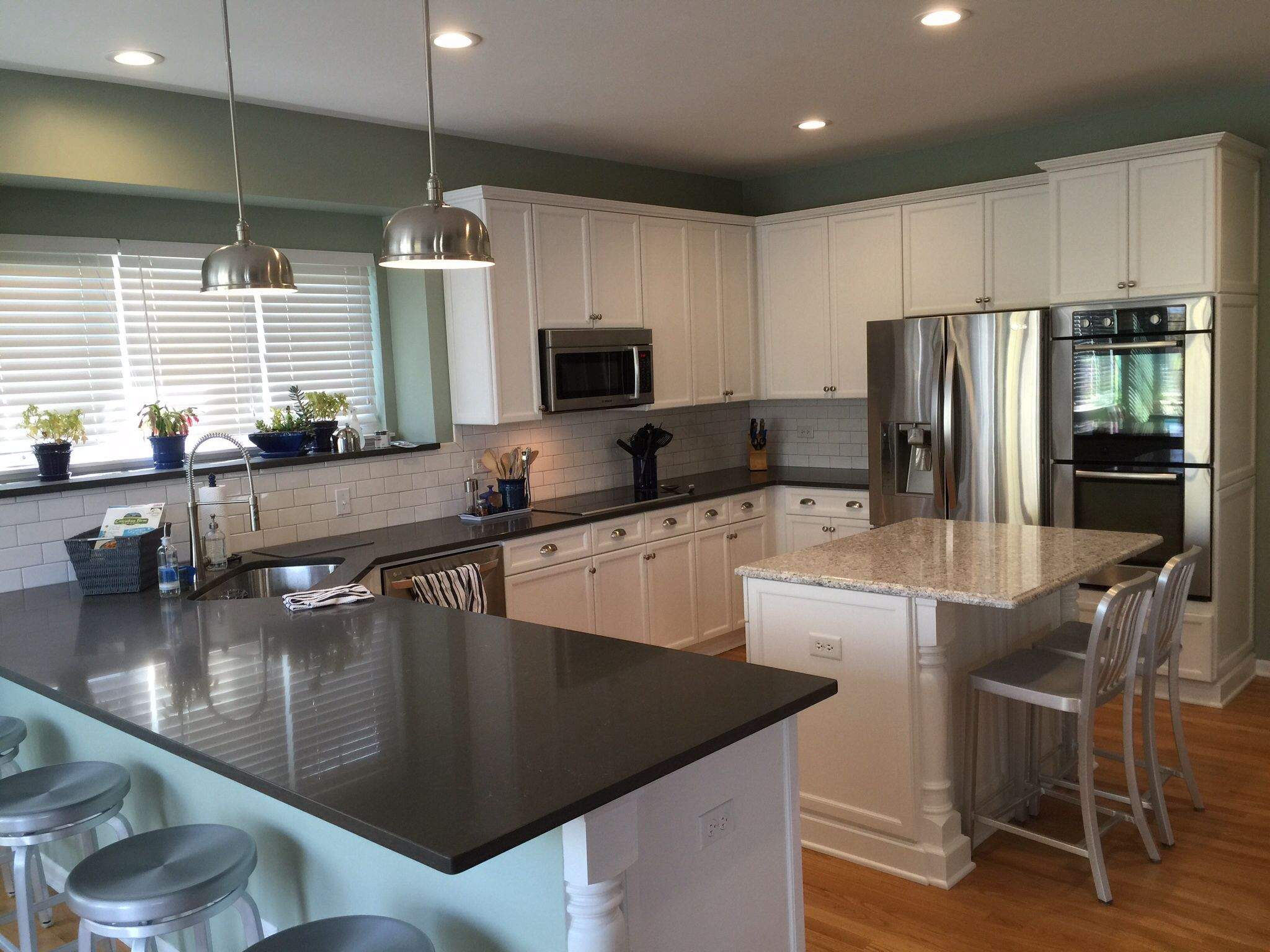 my new kitchen white cabinets and caesarstone counters pietra grey and atlantic salt