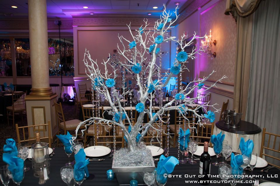 Silver blue tree centerpiece wrapped with led lights