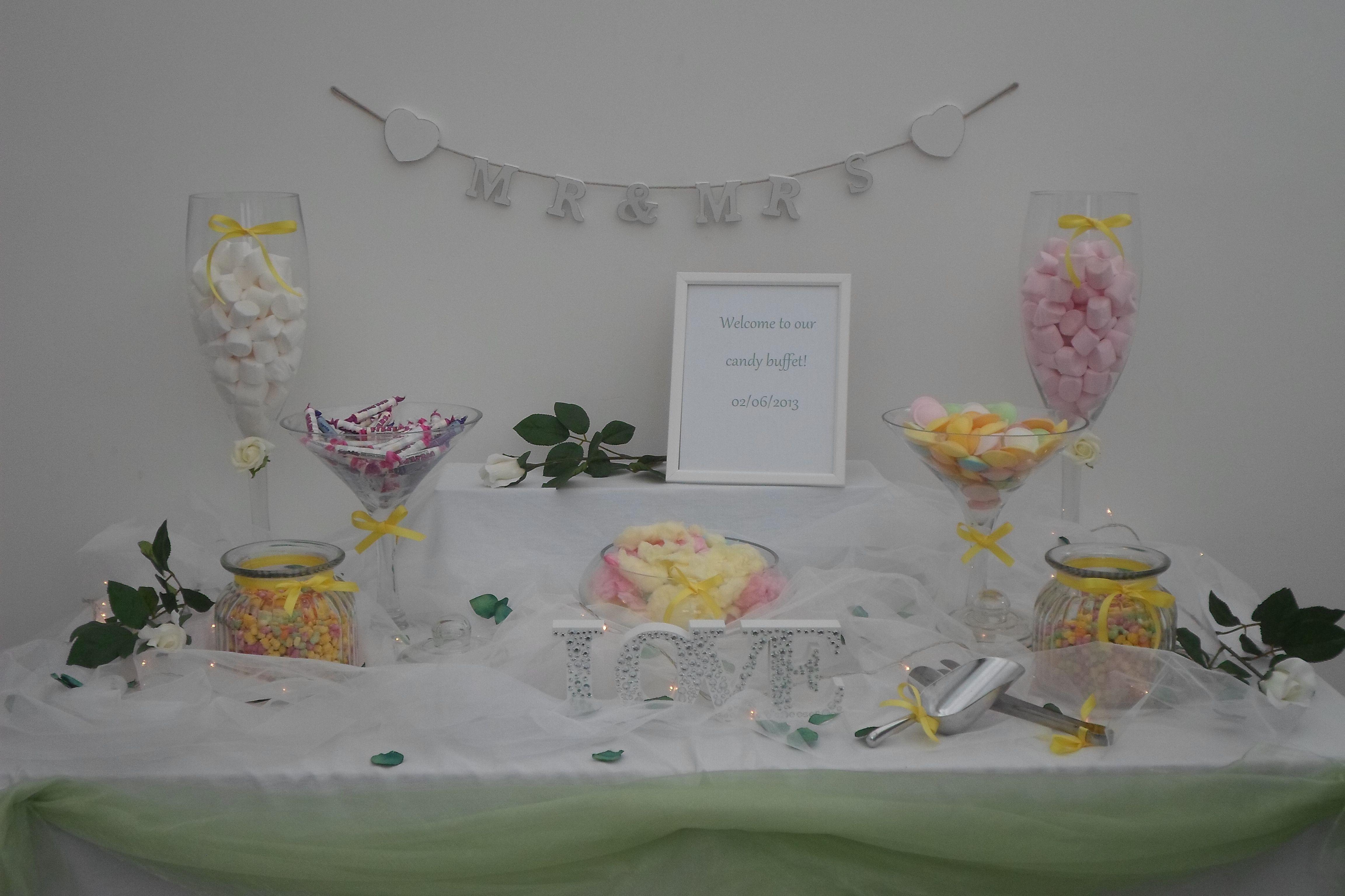 Our wedding candy buffet using a garden theme!