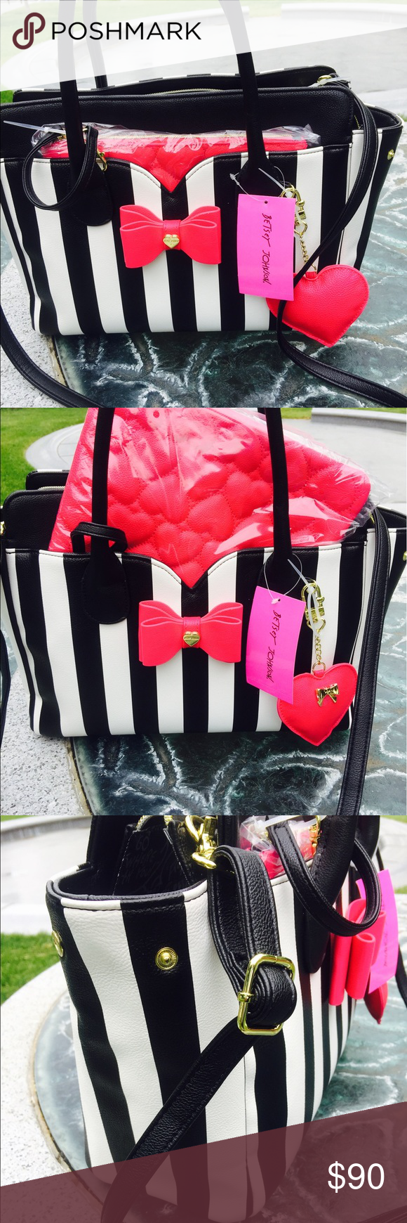 Betsey Johnson satchel bag Betsey Johnson black and white stripes satchel bag with a fuchsia pouch . Has a little discoloration on the bow tie . Betsey Johnson Bags Satchels