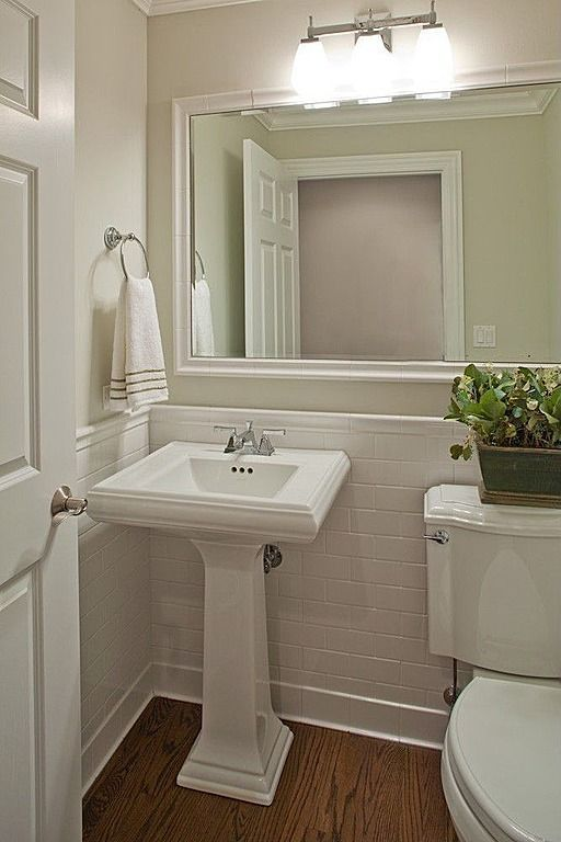 Cute Powder Half Bath With Hardwood Floors Pedestal Sink Crown