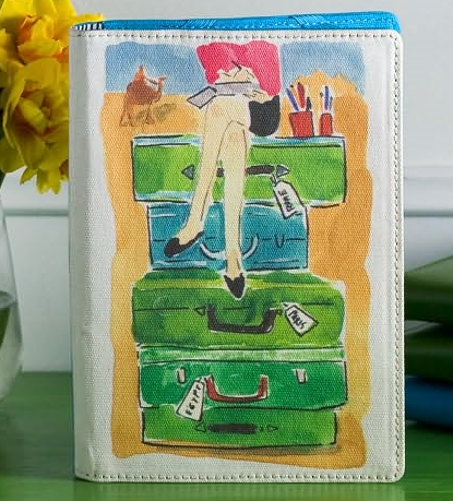 """My Nook cover by Kate Spade--inside reads: """"read a book, travel the world""""."""