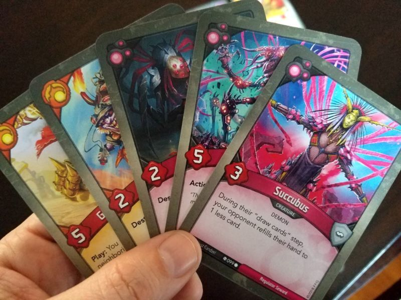 Keyforge The Red Hot Card Game Where Every Deck Is Unique And Unchangeable Game Card Design Card Games Unique Cards