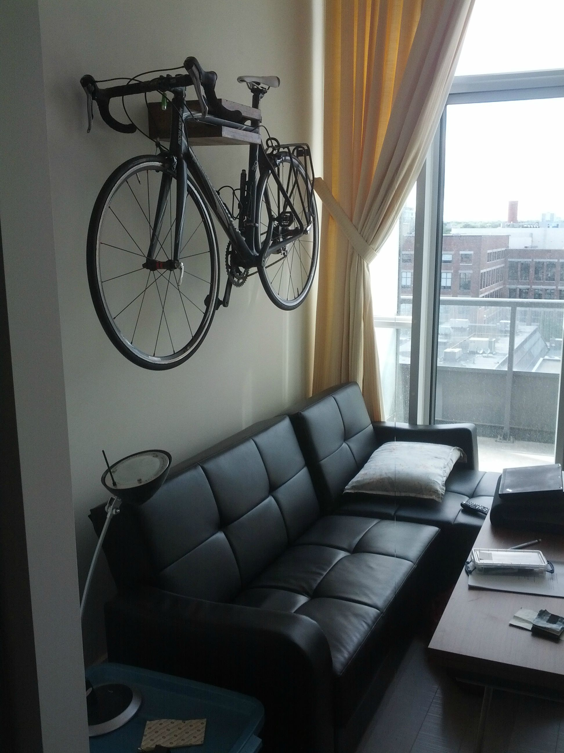 Male Living Space Loft With Bike Wall Mount Small Apartment