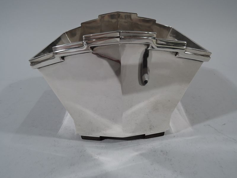 Art Deco 950 silver ice bucket. Made by Tetard Freres in Paris, ca 1930. Trapezoidal with applied rim and two rectangular supports mounted to stained-wood. Sides gently convex with fashionable skyscraper motif. Fully marked with Minerva head and maker's mark. Very good condition. Call For More Info. #FrenchArtDecoIceBucket #SilverIceBucket #ArtDecoSilver #SterlingSilverGifts #SilverAnniversaryGift #SterlingSilverWeddingGifts