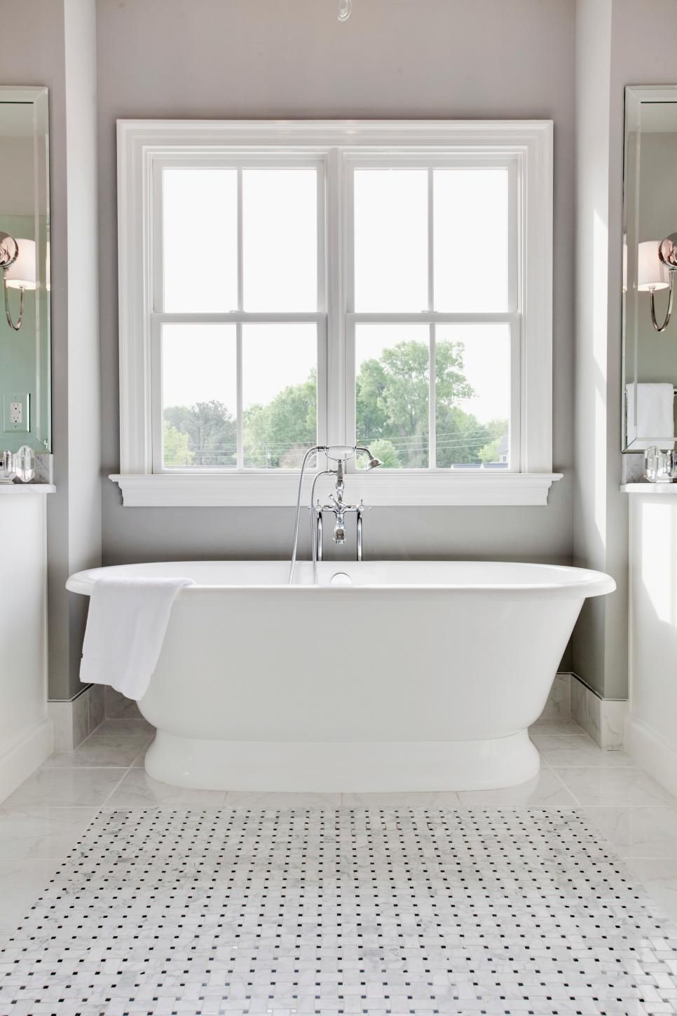 A freestanding soaking tub offers a spa-like retreat in this ...