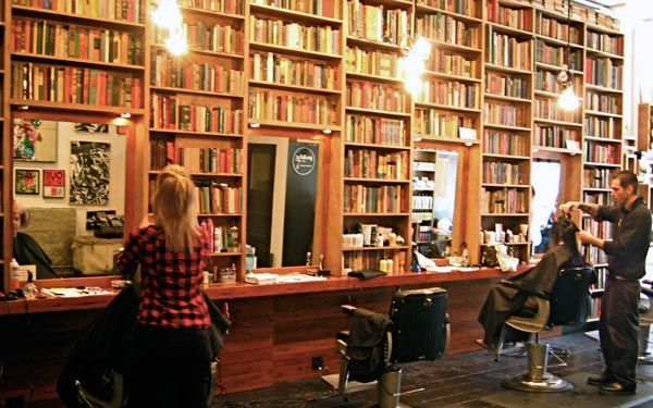 Public Barber Salon | California Home + Design. 90% of the shop's decorations are vintage items (including 4000 books!) from local flea markets and Craigslist.