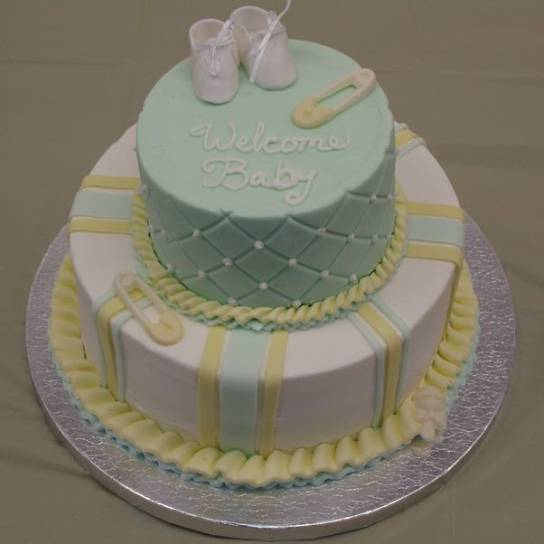 Yellow and green baby shower cake