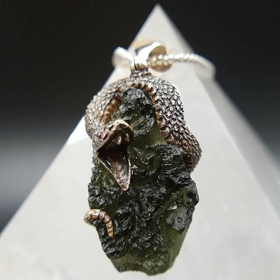 Speed up your spiritual path with this genuine moldavite pendant speed up your spiritual path with this genuine moldavite pendant that features a hand sculpted aloadofball Images