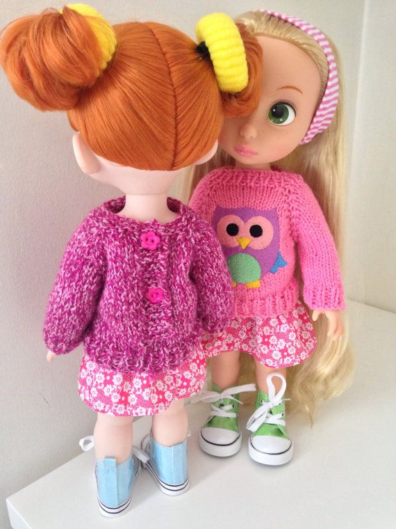 This is a super cute sweater and skirt set for your 16 inch Disney Animator Doll.  The sweater has been handknitted in a pink yarn. The front is