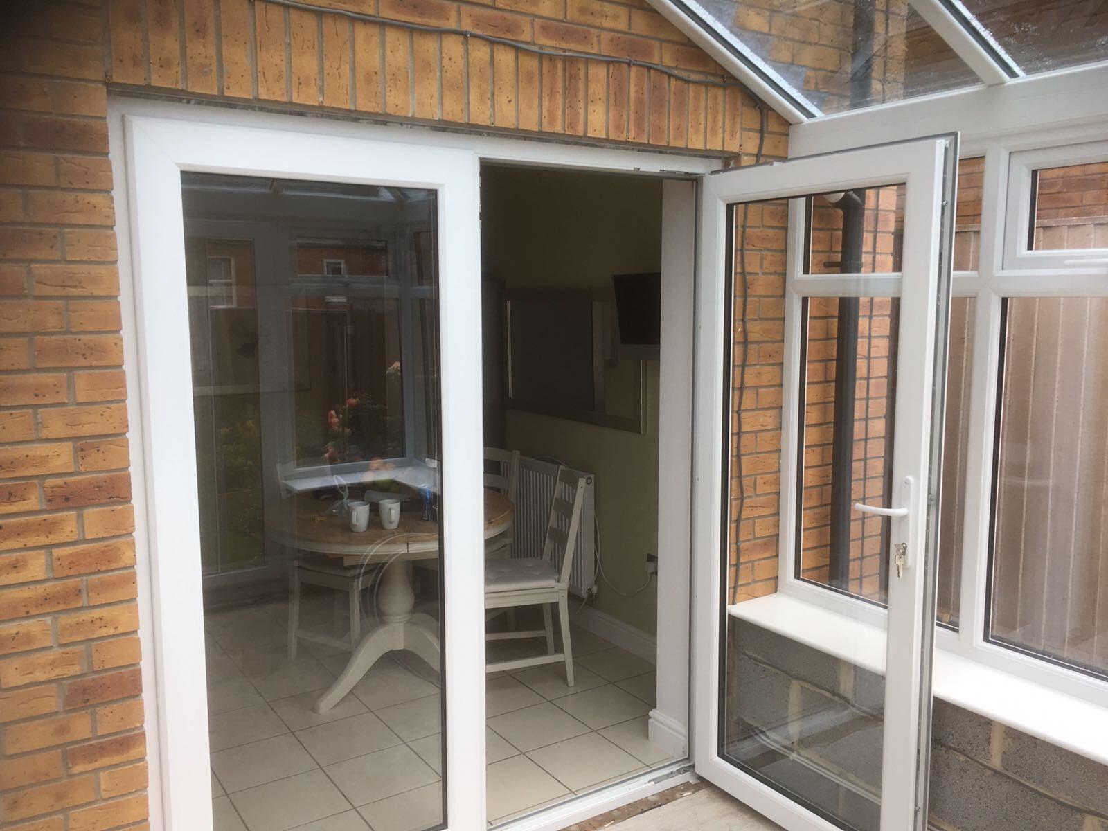 White Kömmerling Premifold swing and slide doors installed