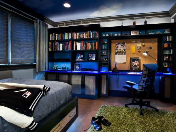 boy's blue bedroom with built-in bookshelf and black desk | game