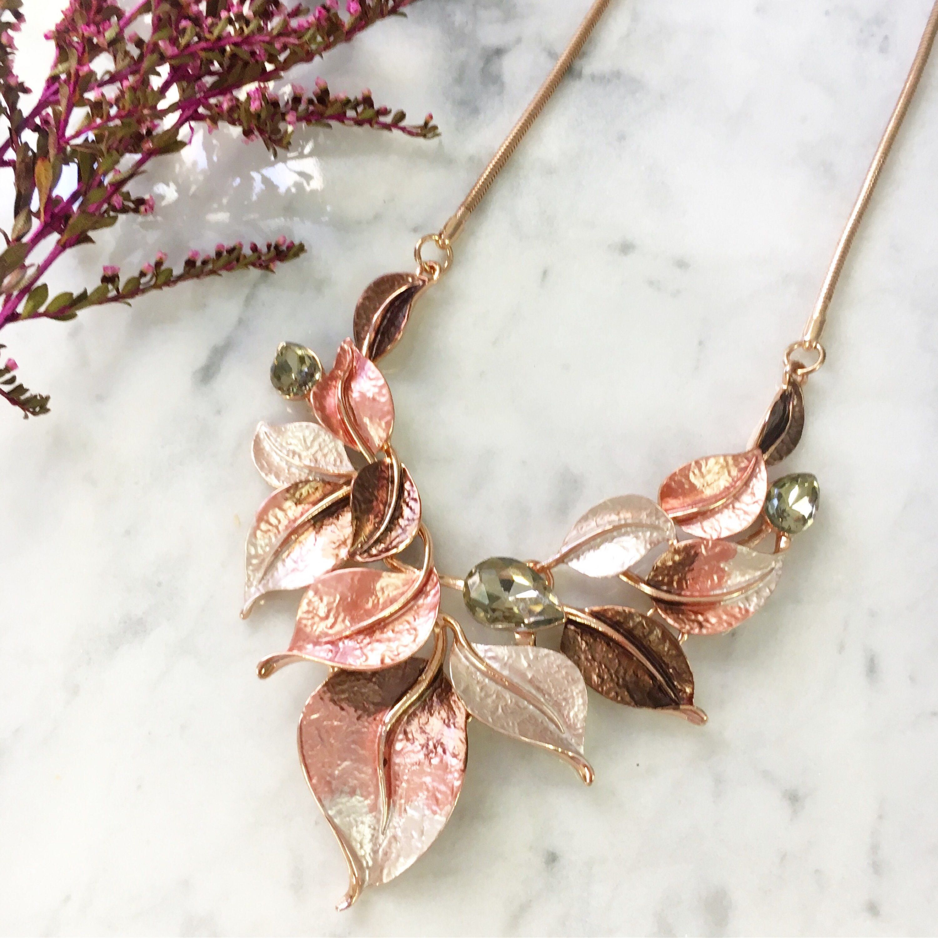 Turn heads in this pretty rose gold statement necklace with pink