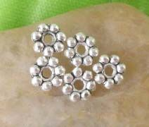 100 Pcs Bright Silver-Plated 4mm Daisy Spacer Beads offered by HalfPennyBoutique, $3.49 https://www.etsy.com/listing/110133906/100-pcs-bright-silver-plated-4mm-daisy