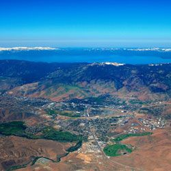 Aerial View Of Carson City Nevada With Lake Tahoe In The