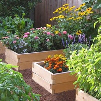 Cedar Raised beds have overlapping corners with a hole through the middle, anchored to the ground with a metal rod. Stackable & have bracing strap across middle to prevent bowing of long beds.