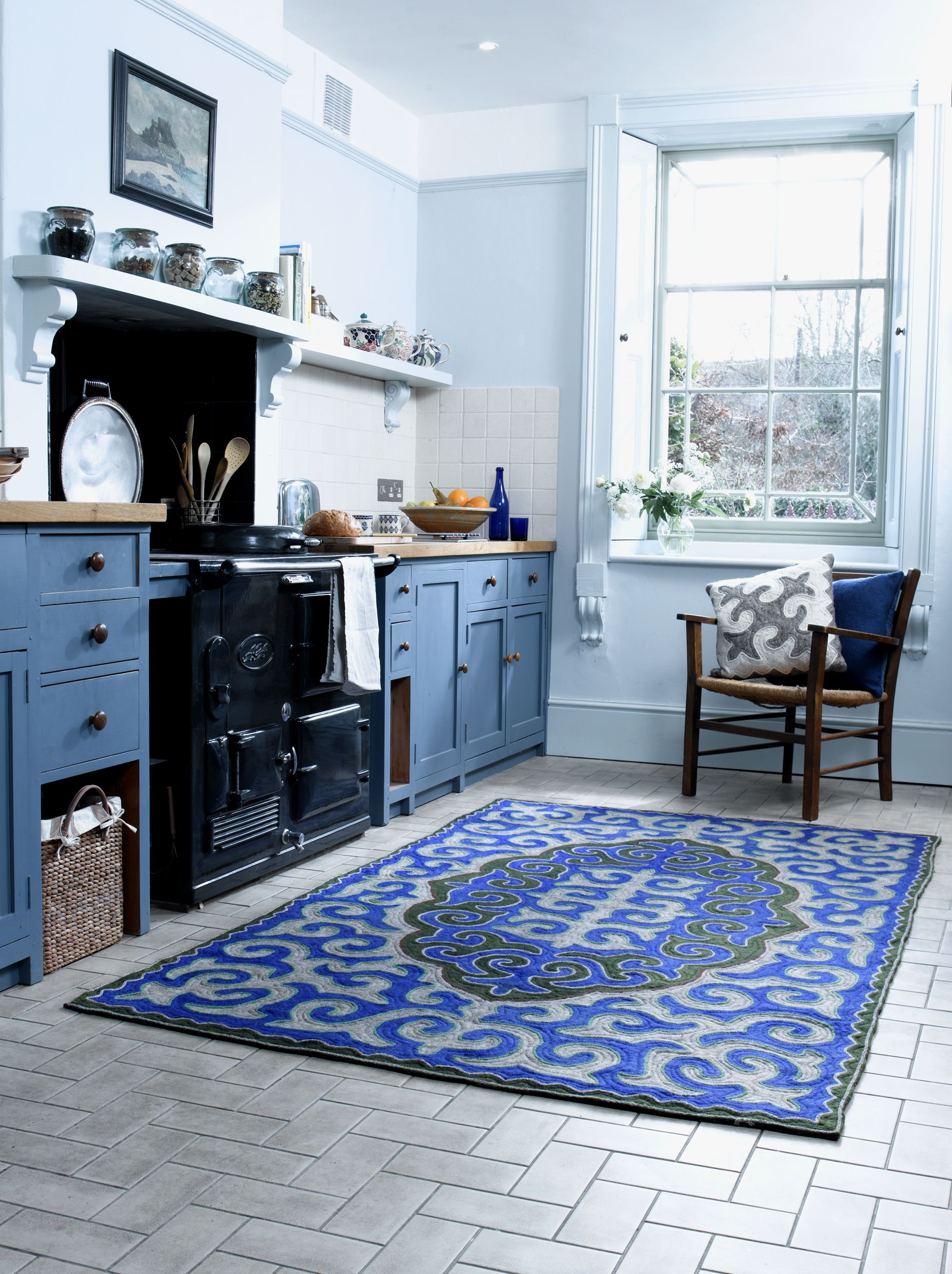 classic country kitchen style complete with a vibrant blue shyrdak