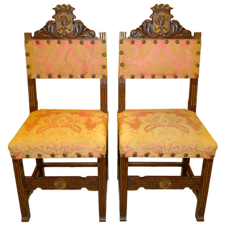 Pair of antique carved spanish hall chairs in original