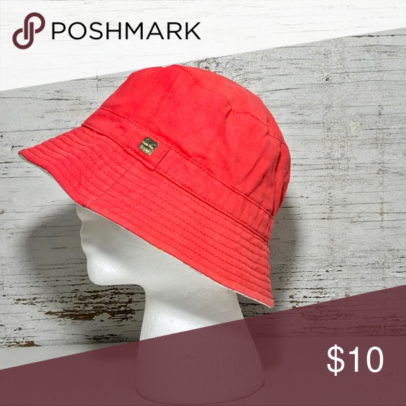 99a5bb7889f Calvin Klein bucket cloche light red hat Light red in color with pastel  print underneath and a gold tone metal décor on the side. Size   small
