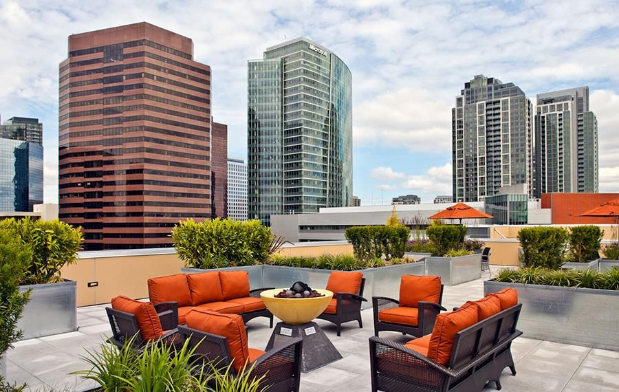Rooftop lounge equipped with BBQ grills, firepit and