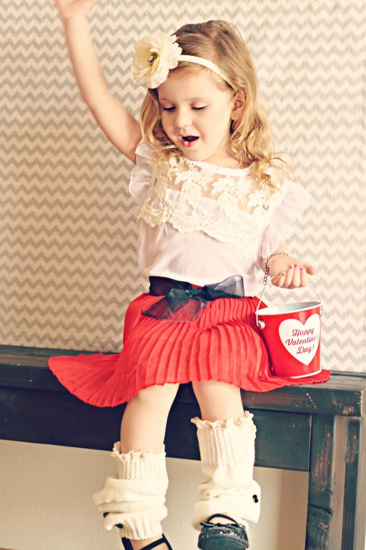 A complete two piece set. White top with floral lace designs, skirt and belt. Designed to bring out her inner fashionista. Check out at: Girls Pleated Red Skirt and Lace Top Outfit