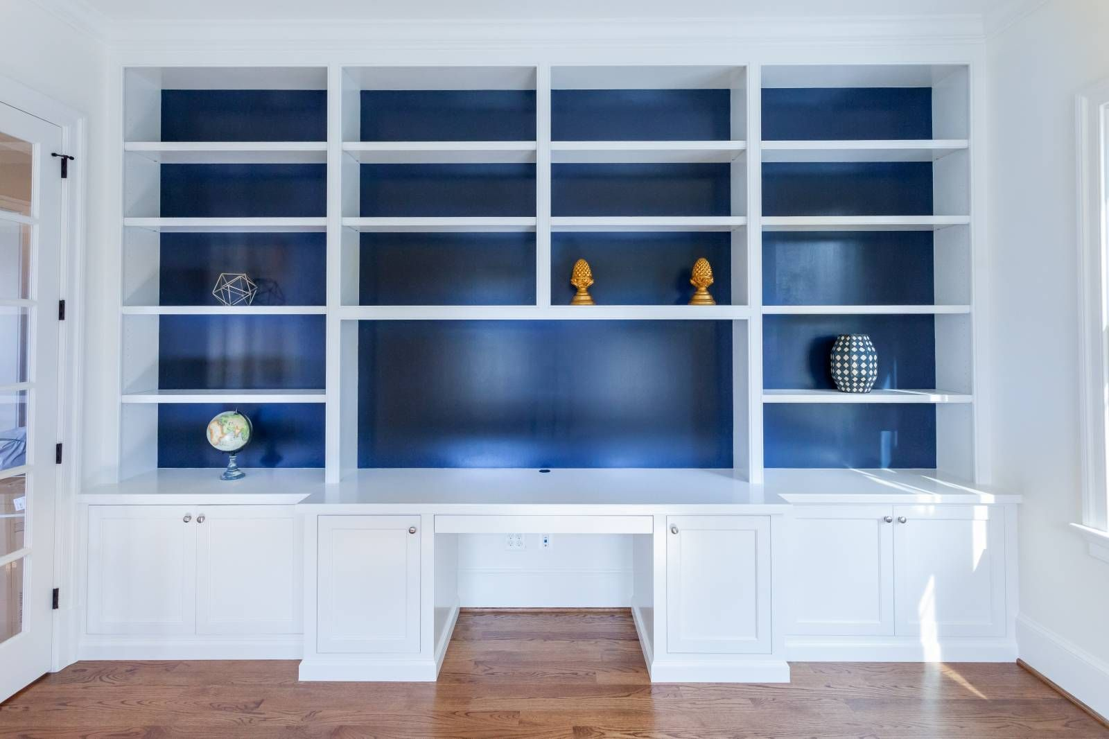 White Library Built In Desk And Open Shelves In Study With Blue Painted Back Bookcases In Custom Home By Bcn Homes In A Built In Desk Home Bookshelves Built In