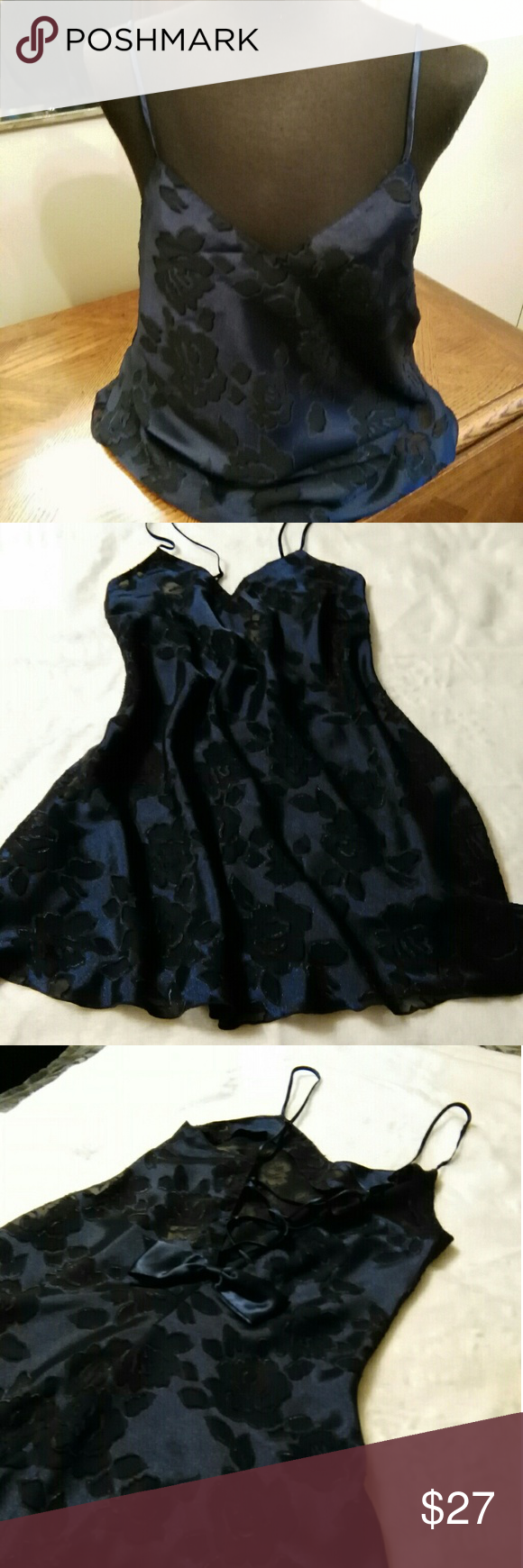 "Victoris's Secret navy blue gown Beautiful navy blue short nite gown with bow at the bottom of the lace up back.  No stains, holes or tears, non smoking home. Length from under arm to hem is 23"". Victoria's Secret Intimates & Sleepwear"